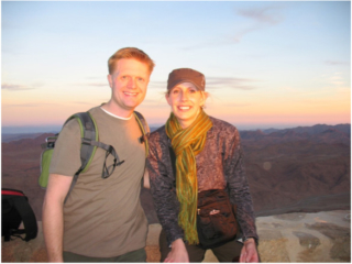 Rachel and her husband, Eric, on Mt. Sinai at sunset.